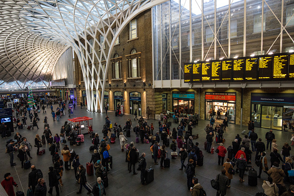 LONDON, ENGLAND - JANUARY 02: Commuters wait to board trains at King's Cross Station on January 2, 2018 in London, England. The average cost of a rail ticket has risen by 3.4% today, the biggest increase since 2013. (Photo by Jack Taylor/Getty Images)
