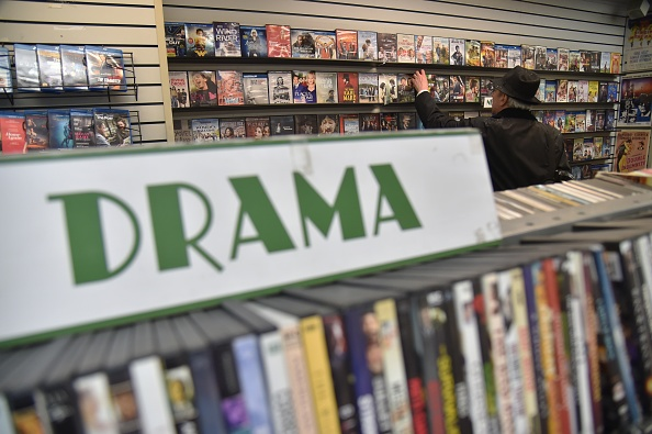 "A client checks movies in a DVD store called ""Video Room"", located on 3rd Avenue in New York City, on April 19, 2018. (Photo by HECTOR RETAMAL / AFP) (Photo credit should read HECTOR RETAMAL/AFP/Getty Images)"