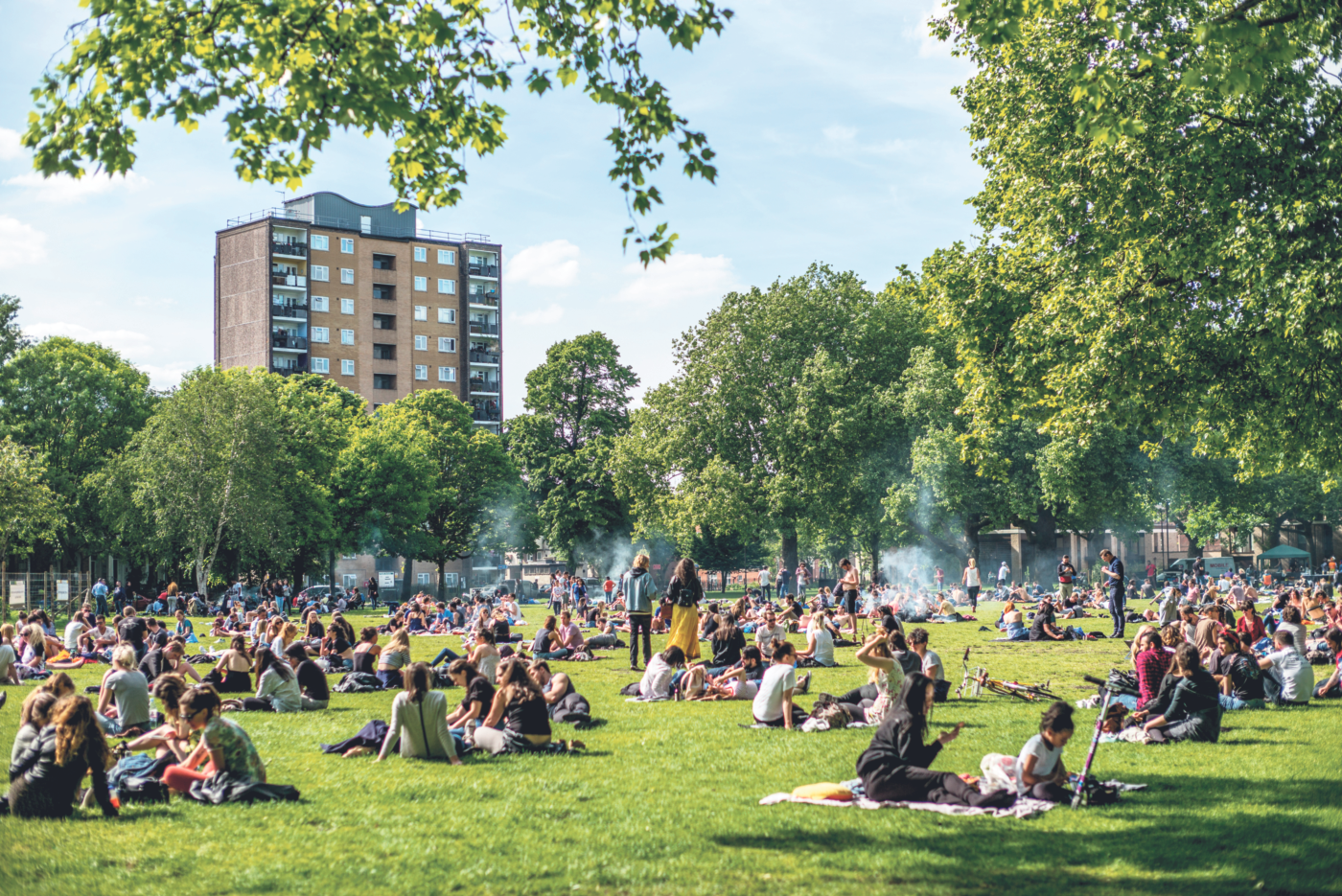 People relax on the grass in London Fields