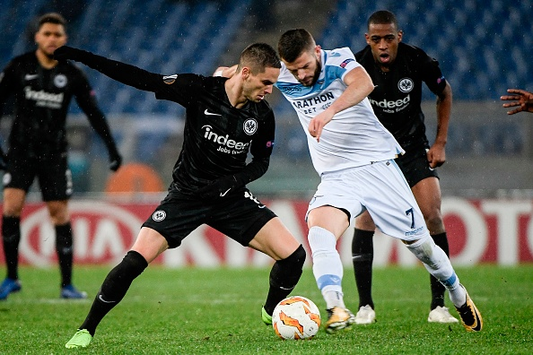 Frankfurt's Serbian midfielder Mijat Gacinovic (L) and Lazio's Kosovo midfielder Valon Berisha go for the ball during the UEFA Europa League group H football match Lazio Rome vs Eintracht Frankfurt on December 13, 2018 at the Olympic stadium in Rome. (Photo by Filippo MONTEFORTE / AFP)        (Photo credit should read FILIPPO MONTEFORTE/AFP/Getty Images)
