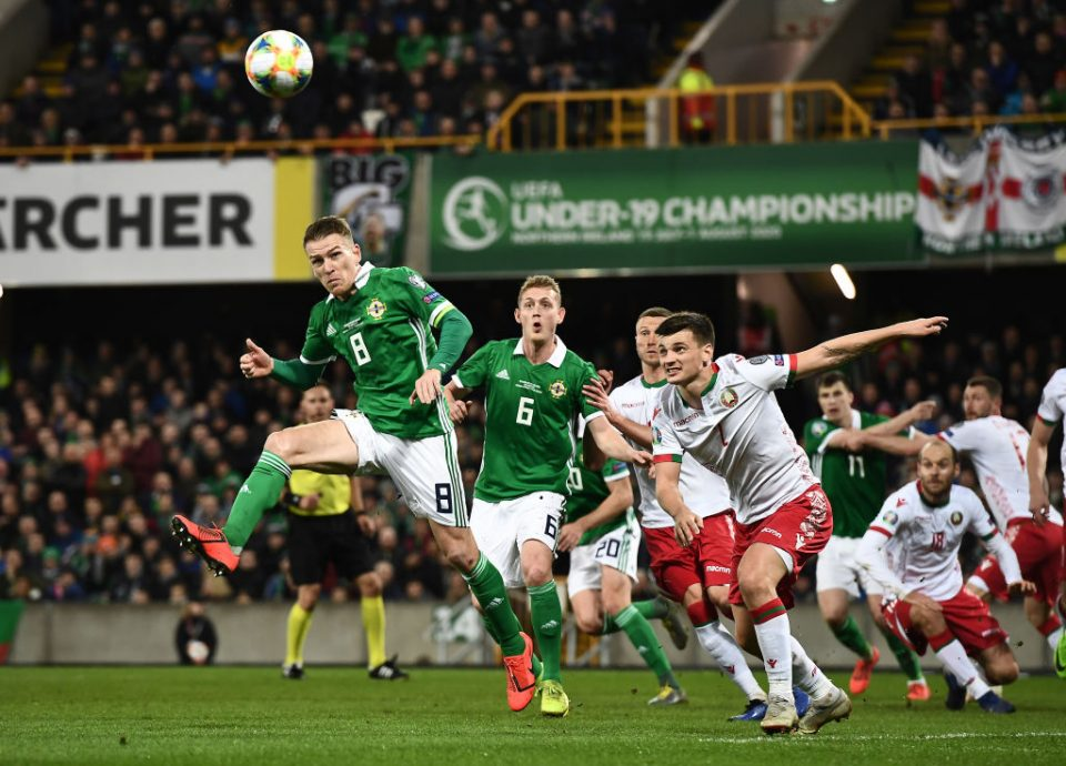 BELFAST, NORTHERN IRELAND - MARCH 24: Steve Davis of Northern Ireland and Yuri Kovalev of Belarus during the 2020 UEFA European Championships group C qualifying match between Northern Ireland and Belarus at Windsor Park on March 24, 2019 in Belfast, United Kingdom. (Photo by Charles McQuillan/Getty Images)