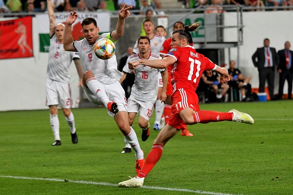 Wales' forward Gareth Bale (R) vies with Hungary's forward Adam Szalai (2nd L) during the UEFA Euro 2020 qualifier Group E football match Hungary against Wales on June 11, 2019 in Budapest. (Photo by ATTILA KISBENEDEK / AFP)        (Photo credit should read ATTILA KISBENEDEK/AFP/Getty Images)