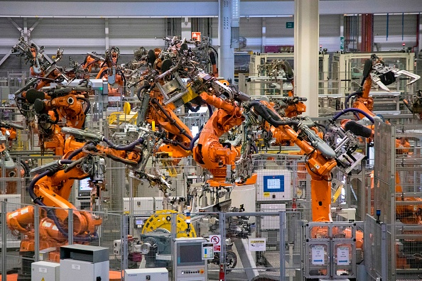UK must adapt to automation or firms will suffer, MPs warn - CityAM