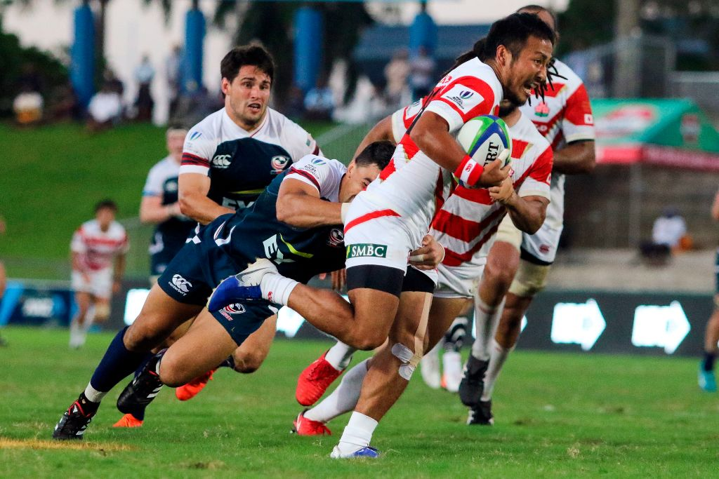 Japan's Yutaka Nagare (R) is tackled by the US Nate Augspurger during their Pacific Nations match in Fiji's capital city Suva on August 10, 2019. (Photo by Lice MOVONO / AFP) (Photo credit should read LICE MOVONO/AFP/Getty Images)