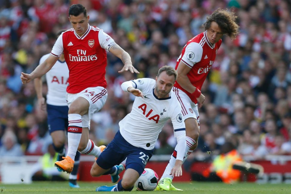 Tottenham Hotspur's Danish midfielder Christian Eriksen (C) vies with Arsenal's Swiss midfielder Granit Xhaka (L) and Arsenal's Brazilian defender David Luiz (R) during the English Premier League football match between Arsenal and Tottenham Hotspur at the Emirates Stadium in London on September 1, 2019. (Photo by Ian KINGTON / IKIMAGES / AFP) / RESTRICTED TO EDITORIAL USE. No use with unauthorized audio, video, data, fixture lists, club/league logos or 'live' services. Online in-match use limited to 45 images, no video emulation. No use in betting, games or single club/league/player publications.        (Photo credit should read IAN KINGTON/AFP/Getty Images)