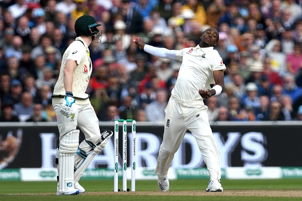 England's Jofra Archer bowls on the first day of the fourth Ashes cricket Test match between England and Australia at Old Trafford in Manchester, north-west England on September 4, 2019. (Photo by Paul ELLIS / AFP) / RESTRICTED TO EDITORIAL USE. NO ASSOCIATION WITH DIRECT COMPETITOR OF SPONSOR, PARTNER, OR SUPPLIER OF THE ECB        (Photo credit should read PAUL ELLIS/AFP/Getty Images)