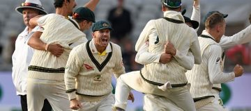 Australia's David Warner (C) celebrates with teammates after Australia win on day five of the fourth Ashes cricket Test match between England and Australia at Old Trafford in Manchester, north-west England on September 8, 2019. - Australia retained the Ashes with a 185-run thrashing of England in the fourth Test at Old Trafford on Sunday. (Photo by Oli SCARFF / AFP) / RESTRICTED TO EDITORIAL USE. NO ASSOCIATION WITH DIRECT COMPETITOR OF SPONSOR, PARTNER, OR SUPPLIER OF THE ECB (Photo credit should read OLI SCARFF/AFP/Getty Images)