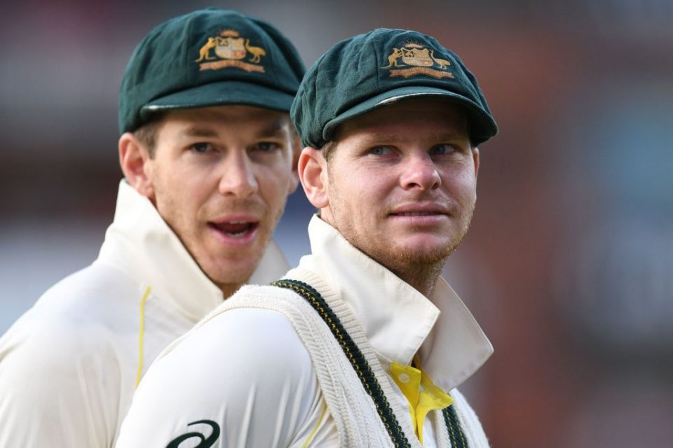 Australia's captain Tim Paine (L) and Australia's Steve Smith (R) celebrate their victory on the field after the fourth Ashes cricket Test match between England and Australia at Old Trafford in Manchester, north-west England on September 8, 2019. - Australia retained the Ashes with a 185-run thrashing of England in the fourth Test at Old Trafford on Sunday. (Photo by Oli SCARFF / AFP) / RESTRICTED TO EDITORIAL USE. NO ASSOCIATION WITH DIRECT COMPETITOR OF SPONSOR, PARTNER, OR SUPPLIER OF THE ECB        (Photo credit should read OLI SCARFF/AFP/Getty Images)