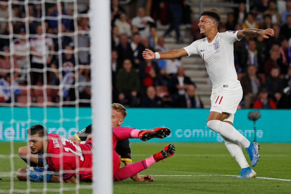 England's midfielder Jadon Sancho (R) celebrates scoring his team's fourth goal during the UEFA Euro 2020 qualifying Group A football match between England and Kosovo at St Mary's stadium in Southampton, southern England on September 10, 2019. (Photo by Adrian DENNIS / AFP) / NOT FOR MARKETING OR ADVERTISING USE / RESTRICTED TO EDITORIAL USE        (Photo credit should read ADRIAN DENNIS/AFP/Getty Images)