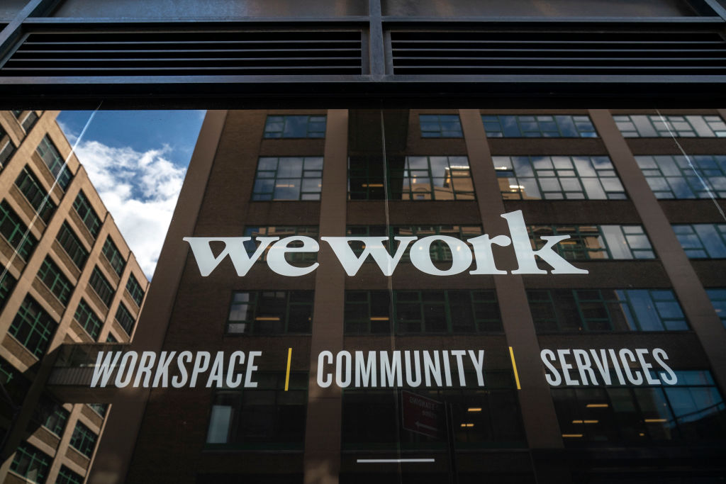 Wework bond tumbles on delay to stock market float