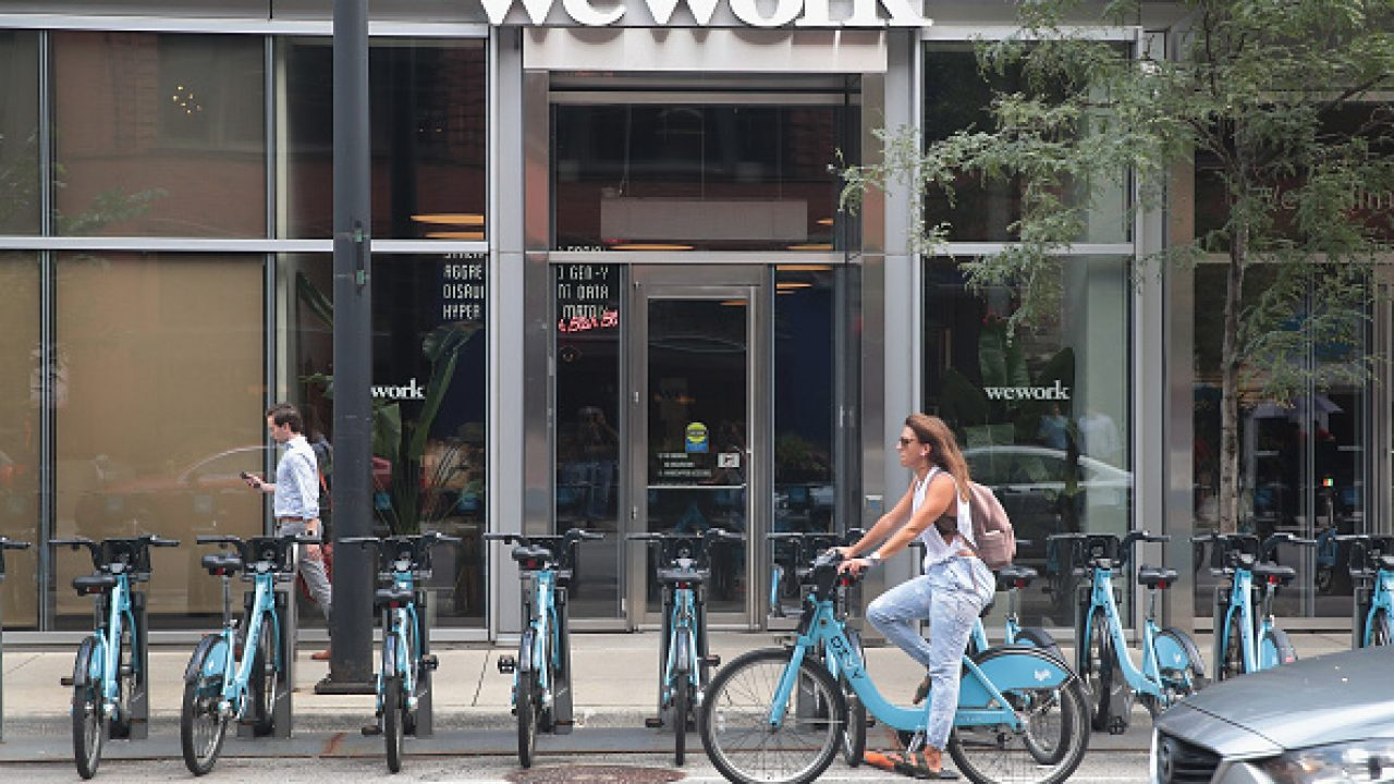 Wework considers cutting its listing valuation by half