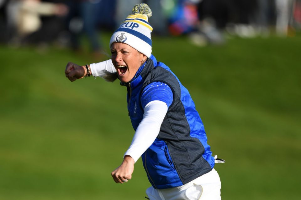 Europe's Suzann Pettersen celebrates after winning her tie on the 18th green in the singles on the third day of The Solheim Cup golf tournament at Gleneagles in Scotland, on September 15, 2019. - Europe regained the Solheim Cup with a thrilling 14.5-13.5 victory over the United States on Sunday at Gleneagles. (Photo by ANDY BUCHANAN / AFP) / RESTRICTED TO EDITORIAL USE (Photo credit should read ANDY BUCHANAN/AFP/Getty Images)