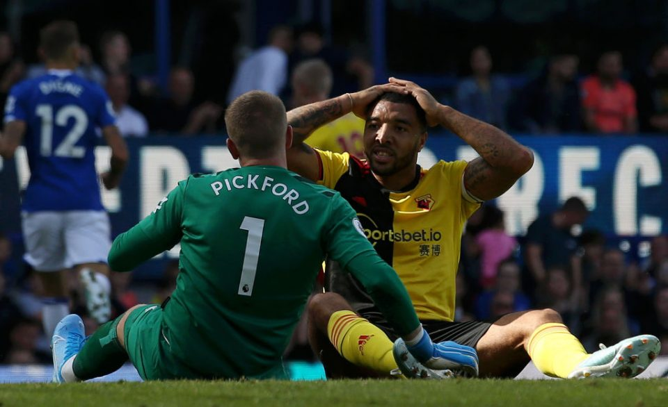 LIVERPOOL, ENGLAND - AUGUST 17: Troy Deeney of Watford and Jordan Pickford of Everton react during the Premier League match between Everton FC and Watford FC at Goodison Park on August 17, 2019 in Liverpool, United Kingdom. (Photo by Jan Kruger/Getty Images)