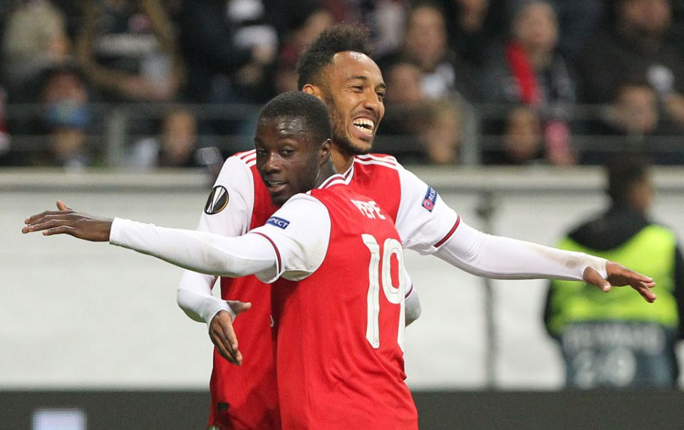 Arsenal's Gabonese striker Pierre-Emerick Aubameyang (L) celebrates scoring the 0-3 with his team-mate French-born Ivorian midfielder Nicolas Pepe during the UEFA Europa League Group F football match Eintracht Frankfurt v Arsenal in Frankfurt am Main, western Germany, on September 19, 2019. (Photo by Daniel ROLAND / AFP) (Photo credit should read DANIEL ROLAND/AFP/Getty Images)