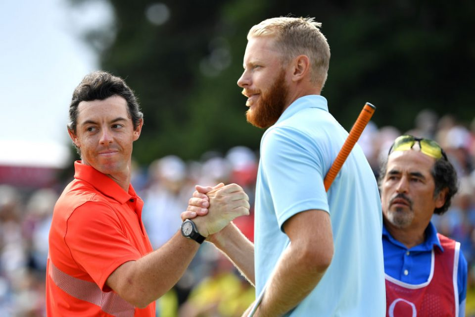 CRANS-MONTANA, SWITZERLAND - SEPTEMBER 01: Rory McIlroy of Northern Ireland shakes hands with Sebastian Soderberg of Sweden on the eighteenth during Day Four of the Omega European Masters at Crans Montana Golf Club on September 01, 2019 in Crans-Montana, Switzerland. (Photo by Stuart Franklin/Getty Images)