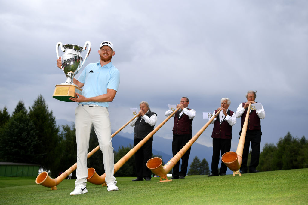 CRANS-MONTANA, SWITZERLAND - SEPTEMBER 01: Sebastian Soderberg of Sweden poses with the trophy following his victory in the play off during Day Four of the Omega European Masters at Crans Montana Golf Club on September 01, 2019 in Crans-Montana, Switzerland. (Photo by Stuart Franklin/Getty Images)