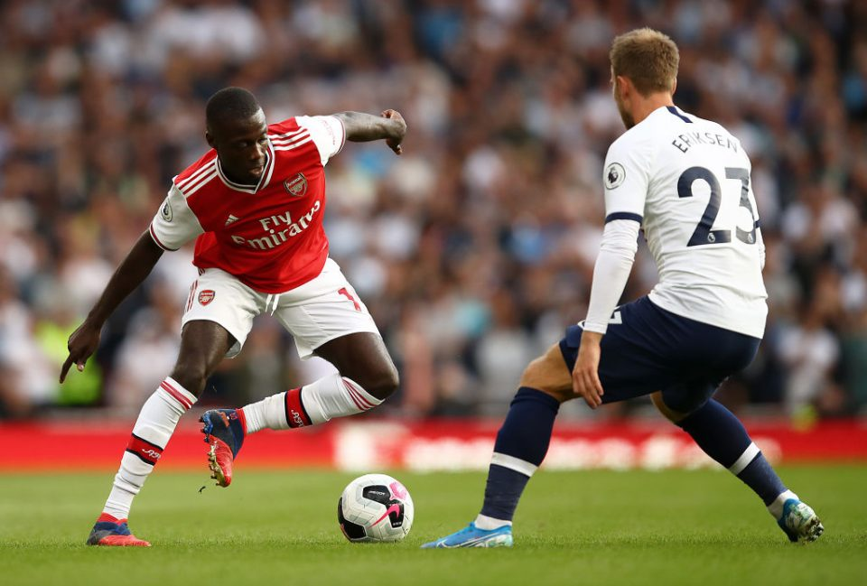 LONDON, ENGLAND - SEPTEMBER 01:  Nicolas Pepe of Arsenal runs at Christian Eriksen of Spurs during the Premier League match between Arsenal FC and Tottenham Hotspur at Emirates Stadium on September 01, 2019 in London, United Kingdom. (Photo by Julian Finney/Getty Images)