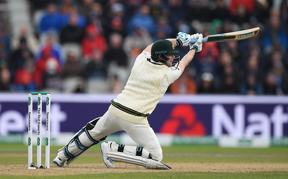 MANCHESTER, ENGLAND - SEPTEMBER 04: Australia batsman Steve Smith drives to the boundary for 4 runs to reach his half century during day one of the 4th Ashes Test match between England and Australia at Old Trafford on September 04, 2019 in Manchester, England. (Photo by Stu Forster/Getty Images)