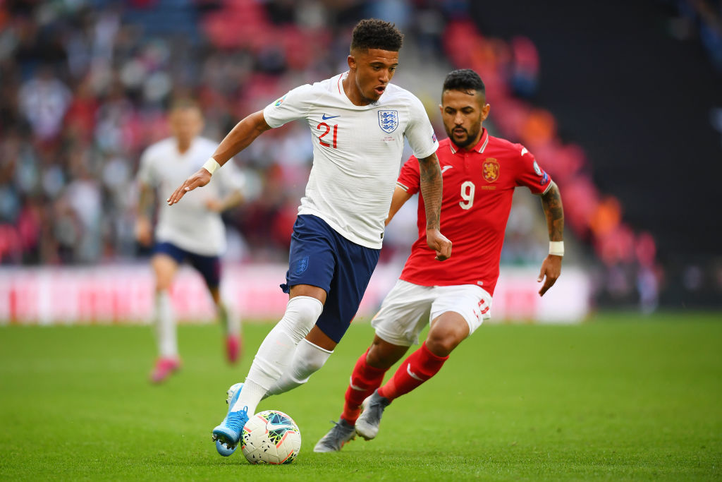 LONDON, ENGLAND - SEPTEMBER 07: Jadon Sancho of England controls the ball as Wanderson of Bulgaria looks on during the UEFA Euro 2020 qualifier match between England and Bulgaria at Wembley Stadium on September 07, 2019 in London, England. (Photo by Clive Mason/Getty Images)