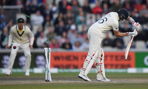 MANCHESTER, ENGLAND - SEPTEMBER 07: England batsman Joe Root is bowled by Australia bowler Pat Cummins for 0 during day four of the 4th Ashes Test Match between England and Australia at Old Trafford on September 07, 2019 in Manchester, England. (Photo by Stu Forster/Getty Images)