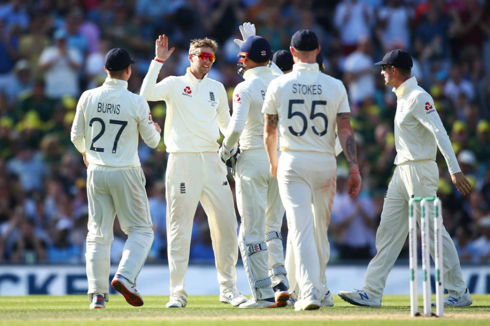 LONDON, ENGLAND - SEPTEMBER 15: Joe Root of England celebrates with his teammates after dismissing Mitchell Marsh of Australia during day four of the 5th Specsavers Ashes Test between England and Australia at The Kia Oval on September 15, 2019 in London, England. (Photo by Jordan Mansfield/Getty Images for Surrey CCC)