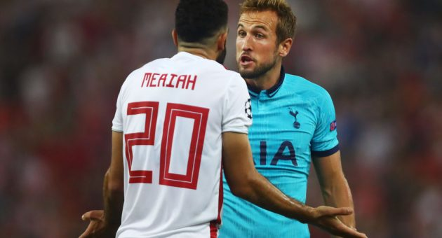 PIRAEUS, GREECE - SEPTEMBER 18: Harry Kane of Tottenham Hotspur clashes with Yassine Meriah of Olympiacos after the awarding of Tottenham Hotspur's first penalty during the UEFA Champions League group B match between Olympiacos FC and Tottenham Hotspur at Karaiskakis Stadium on September 18, 2019 in Piraeus, Greece. (Photo by Dean Mouhtaropoulos/Getty Images)