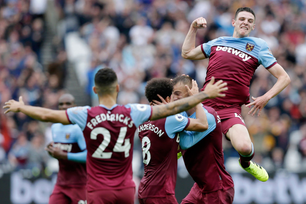 LONDON, ENGLAND - SEPTEMBER 22: Andriy Yarmolenko of West Ham United celebrates with teammates Felipe Anderson and Declan Rice after scoring his team's first goal during the Premier League match between West Ham United and Manchester United at London Stadium on September 22, 2019 in London, United Kingdom. (Photo by Henry Browne/Getty Images)