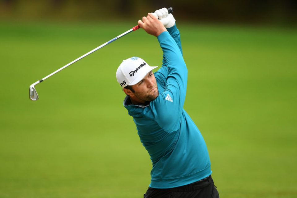 VIRGINIA WATER, ENGLAND - SEPTEMBER 22:  Jon Rahm of Spain plays his second shot on the 12th hole during Day 4 of the BMW PGA Championship at Wentworth Golf Club on September 22, 2019 in Virginia Water, United Kingdom. (Photo by Harry Trump/Getty Images)