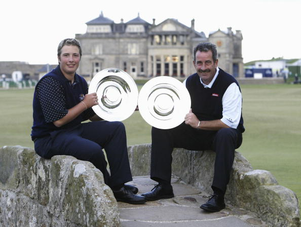 ST ANDREWS, SCOTLAND - SEPTEMBER  28:  Daniel and Sam Torrance pose with their trophies after winning the Team Competition at the Dunhill Links Championship September 28, 2003 on the Old Course, St Andrews, Scotland.  (Photo by Andrew Redington/Getty Images)