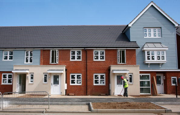 SLOUGH, UNITED KINGDOM - JULY 01: A Barratt homes new-build site under construction on July 1, 2008 in Slough, England. New build housing companies are struggling during the current credit crunch, as people find it increasingly diifficult to buy, sell and get a good mortgage deal that suits their needs. (Photo by Cate Gillon/Getty Images)