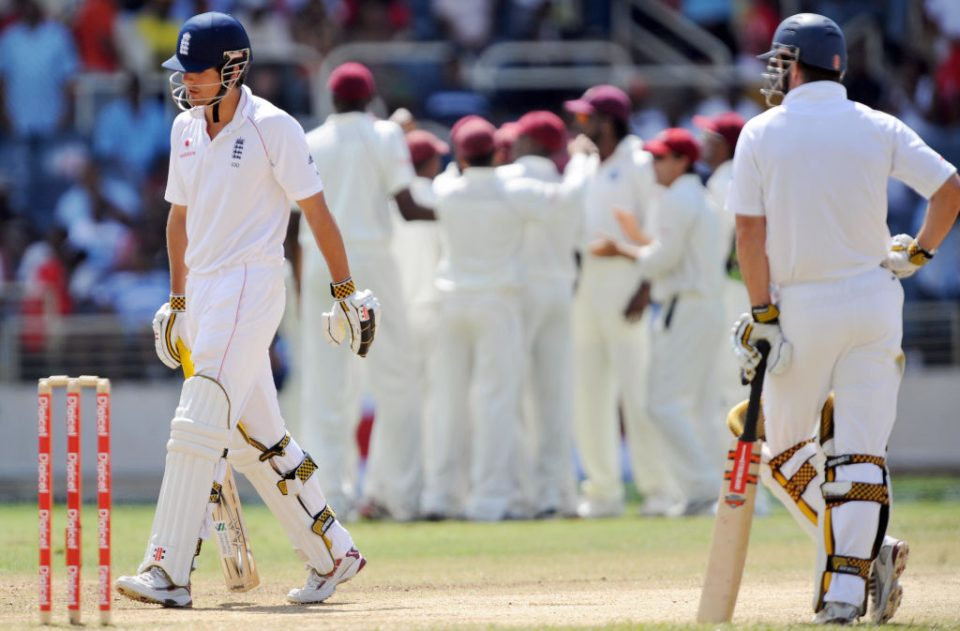 England's batsman Alastair Cook (L) leaves the field after being dismissed off West Indies bowler Jerome Taylor as his team captain Andrew Strauss (R) looks on during the fourth day of the first Test match between England and West Indies at the Sabina Park Cricket Groud in Kingston on February 7, 2009. West Indies lead by 74 runs at the end of first innings play.         AFP PHOTO/Jewel SAMAD (Photo credit should read JEWEL SAMAD/AFP/Getty Images)