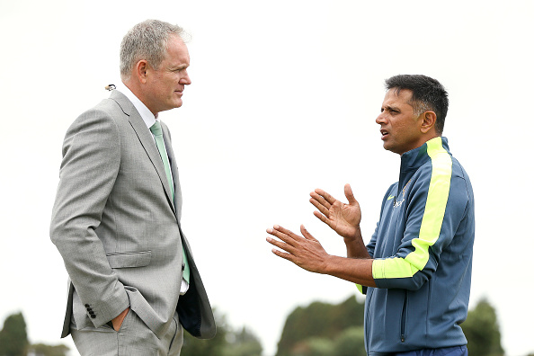 TAURANGA, NEW ZEALAND - JANUARY 16:  Commentator Tom Moody speaks to coach Rahul Dravid of India during the ICC U19 Cricket World Cup match between India and Papua New Guinea at Bay Oval on January 16, 2018 in Tauranga, New Zealand.  (Photo by Hagen Hopkins/Getty Images)