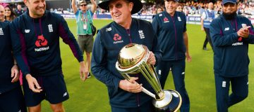 LONDON, ENGLAND - JULY 14: England coach Trevor Bayliss celebrates with the trophy after winning the Final of the ICC Cricket World Cup 2019 between New Zealand and England at Lord's Cricket Ground on July 14, 2019 in London, England. (Photo by Gareth Copley-IDI/IDI via Getty Images)