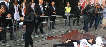 Extinction Rebellion protesters cover themselves in fake blood at London Fashion Week 'die-in'