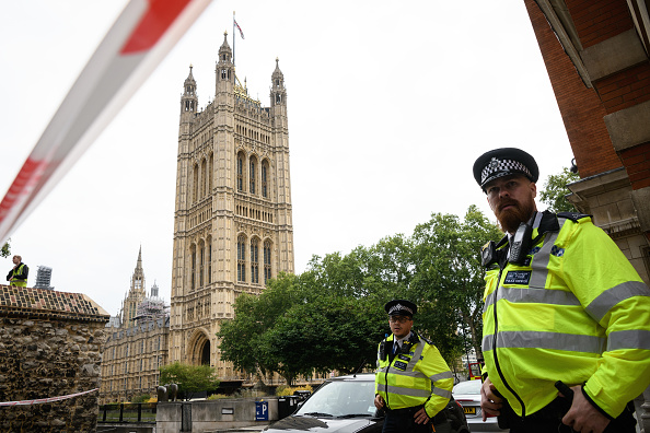 Police pin man to ground outside parliament as anti-Brexit protests reach Westminster