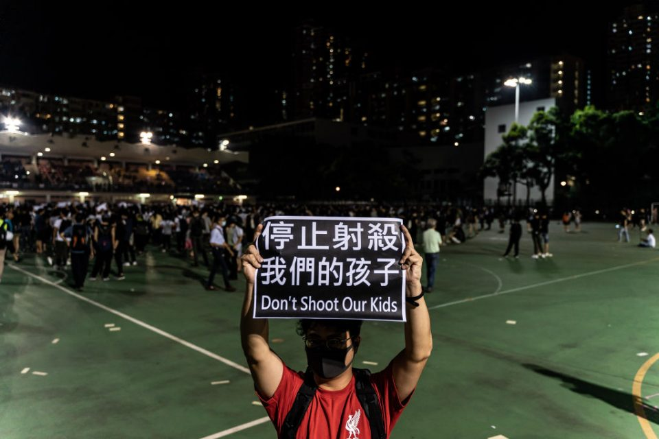 Hong Kong protester holds placard reading 'Don't shoot our kids'