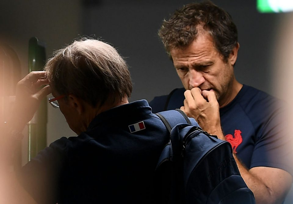 France's head coach Jacques Brunel (L) speaks with the assistant coach Fabien Galthie at the end of a training session at the Suizenji Athletic Field in Kumamoto, on October 8, 2019, during the Japan 2019 Rugby World Cup. (Photo by FRANCK FIFE / AFP) (Photo by FRANCK FIFE/AFP via Getty Images)