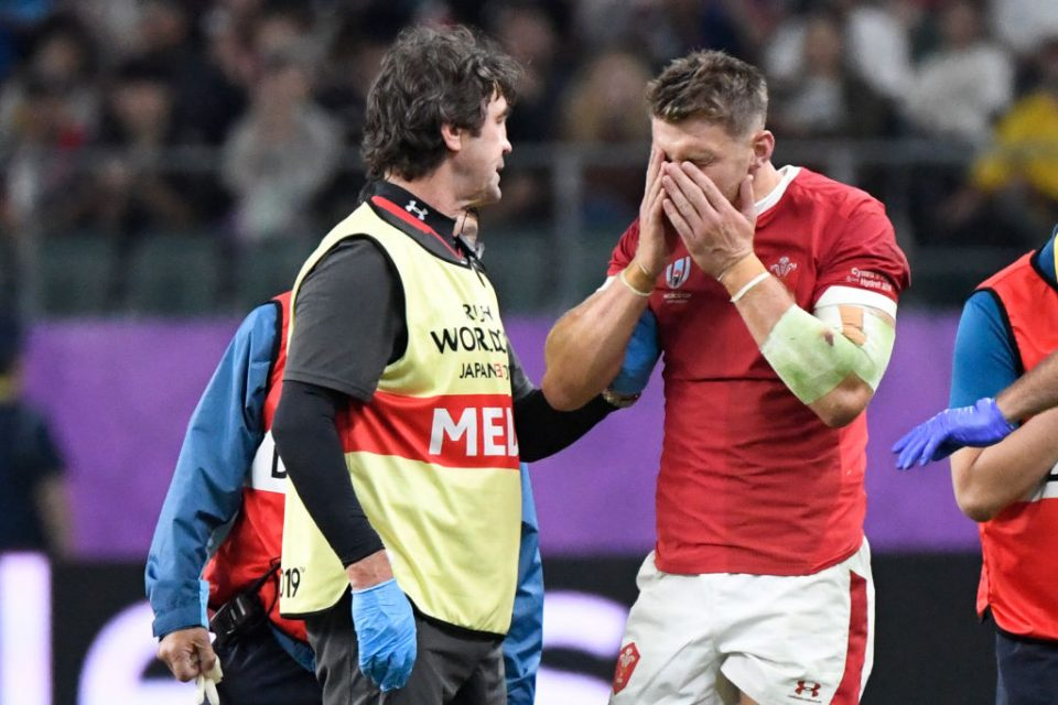 Wales' fly-half Dan Biggar (R) reacts after an injury during the Japan 2019 Rugby World Cup Pool D match between Wales and Fiji at the Oita Stadium in Oita on October 9, 2019. (Photo by CHRISTOPHE SIMON / AFP) (Photo by CHRISTOPHE SIMON/AFP via Getty Images)