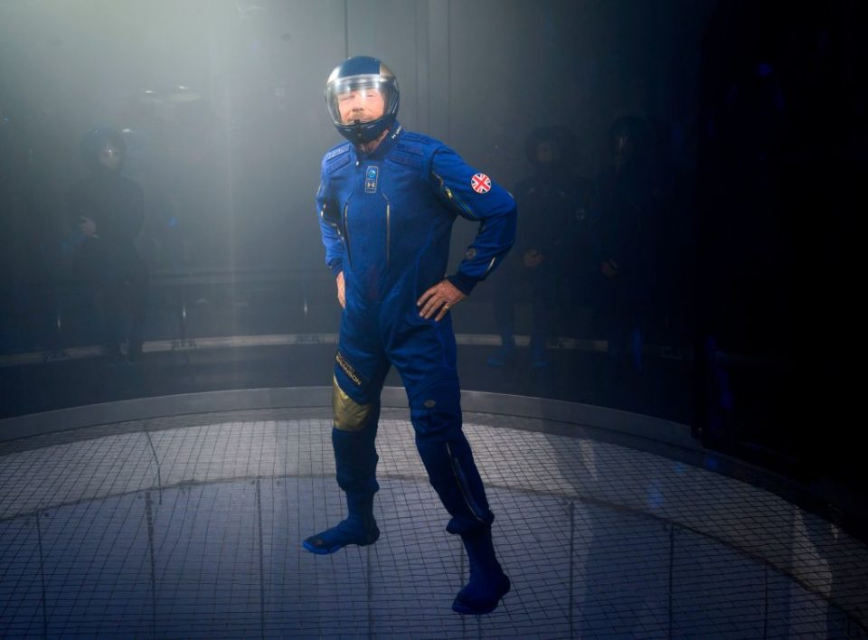 Virgin Galactic boss Sir Richard Branson demonstrates one of his spacesuits (Getty Images)