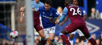 Everton's Brazilian striker Bernard (C) scores his team's first goal during the English Premier League football match between Everton and West Ham United at Goodison Park in Liverpool, north west England on October 19, 2019. (Photo by Paul ELLIS / AFP) / RESTRICTED TO EDITORIAL USE. No use with unauthorized audio, video, data, fixture lists, club/league logos or 'live' services. Online in-match use limited to 120 images. An additional 40 images may be used in extra time. No video emulation. Social media in-match use limited to 120 images. An additional 40 images may be used in extra time. No use in betting publications, games or single club/league/player publications. / (Photo by PAUL ELLIS/AFP via Getty Images)