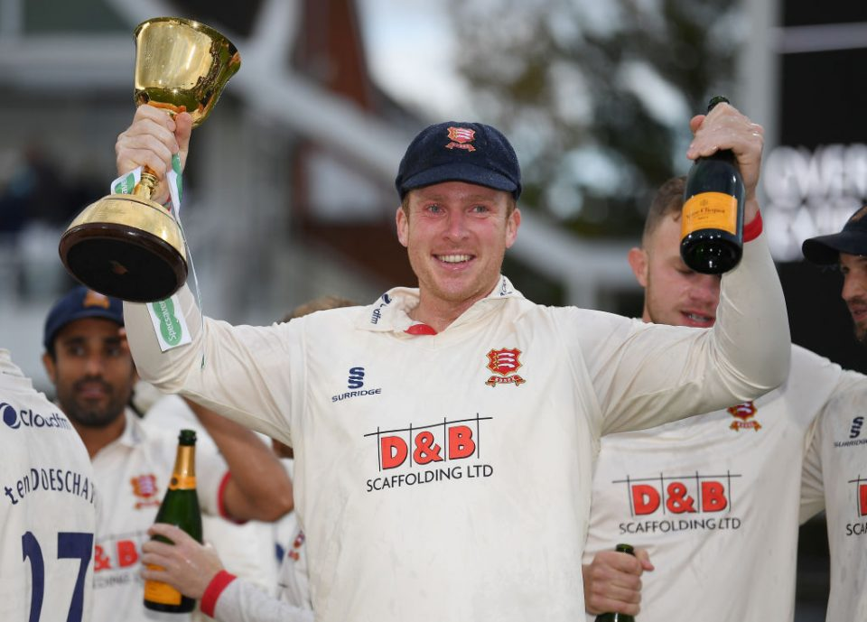 TAUNTON, ENGLAND - SEPTEMBER 26: Simon Harmer of Essex with the Specsavers County Championship Trophy  during Day Four of the Specsavers County Championship Division One match between Somerset and Essex at The Cooper Associates County Ground on September 26, 2019 in Taunton, England. (Photo by Alex Davidson/Getty Images)