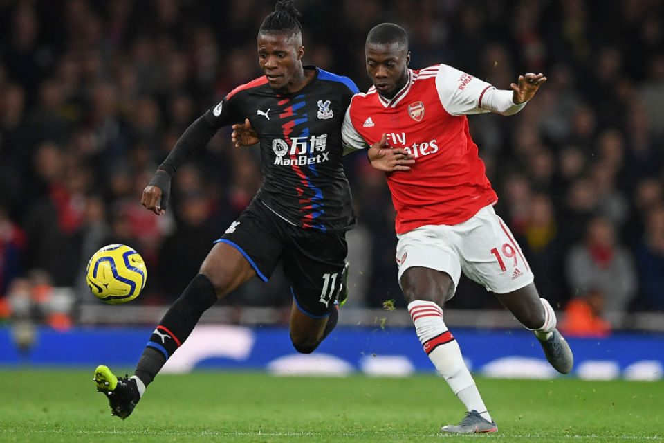 Crystal Palace's Ivorian striker Wilfried Zaha (L) vies with Arsenal's French-born Ivorian midfielder Nicolas Pepe (R) during the English Premier League football match between Arsenal and Crystal Palace at the Emirates Stadium in London on October 27, 2019. (Photo by DANIEL LEAL-OLIVAS / AFP) / RESTRICTED TO EDITORIAL USE. No use with unauthorized audio, video, data, fixture lists, club/league logos or 'live' services. Online in-match use limited to 120 images. An additional 40 images may be used in extra time. No video emulation. Social media in-match use limited to 120 images. An additional 40 images may be used in extra time. No use in betting publications, games or single club/league/player publications. / (Photo by DANIEL LEAL-OLIVAS/AFP via Getty Images)