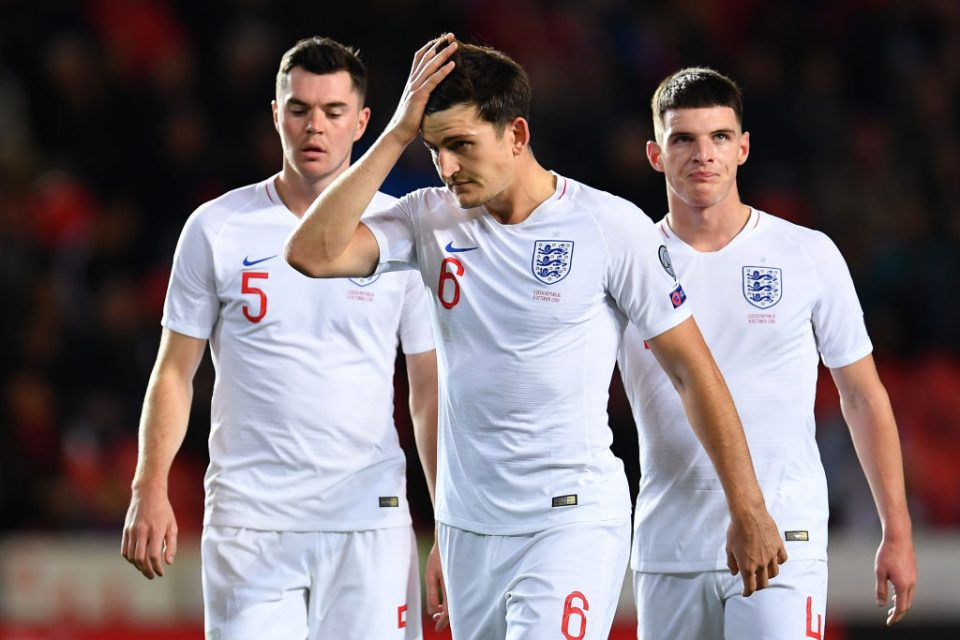 PRAGUE, CZECH REPUBLIC - OCTOBER 11:  Michael Keane , Harry Maguire and Declan Rice of England look dejected during the UEFA Euro 2020 qualifier between Czech Republic and England at Sinobo Stadium on October 11, 2019 in Prague, Czech Republic. (Photo by Justin Setterfield/Getty Images)