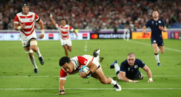 YOKOHAMA, JAPAN - OCTOBER 13: Kenki Fukuoka of Japan dives to score their third try as Scotland player Stuart Hogg reacts during the Rugby World Cup 2019 Group A game between Japan and Scotland at International Stadium Yokohama on October 13, 2019 in Yokohama, Kanagawa, Japan. (Photo by Stu Forster/Getty Images)