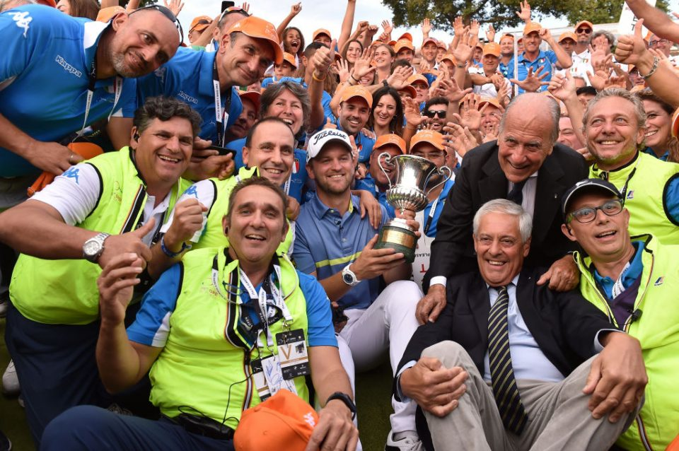 ROME, ITALY - OCTOBER 13: The winner Bernd Wiesberger of Austria with the trophy taking a photo with the volounteers at the end of the Round 4 at Olgiata Golf Club on October 13, 2019 in Rome, Italy. (Photo by Tullio M. Puglia/Getty Images)