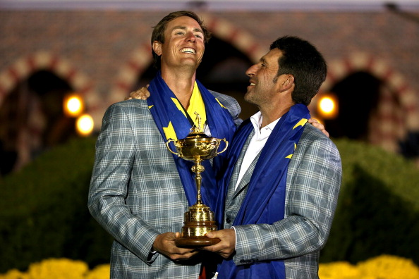MEDINAH, IL - SEPTEMBER 30:  European team captain Jose Maria Olazabal poses with Nicolas Colsaerts and the Ryder Cup after Europe defeated the USA 14.5 to 13.5 to retain the Ryder Cup during the Singles Matches for The 39th Ryder Cup at Medinah Country Club on September 30, 2012 in Medinah, Illinois.  (Photo by Ross Kinnaird/Getty Images)