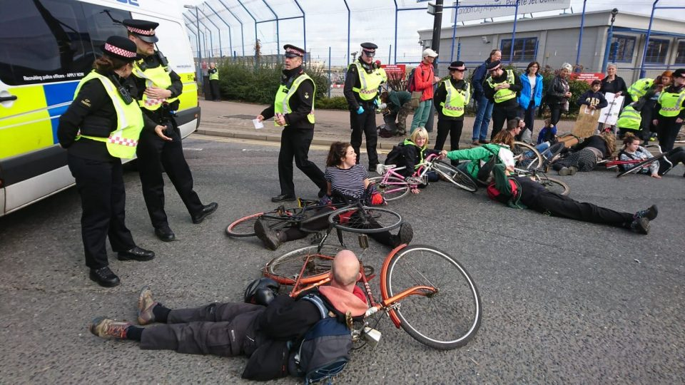 Police arrest Extinction Rebellion protesters trying to block London City Airport's private jet terminal (Jamie Lowe)