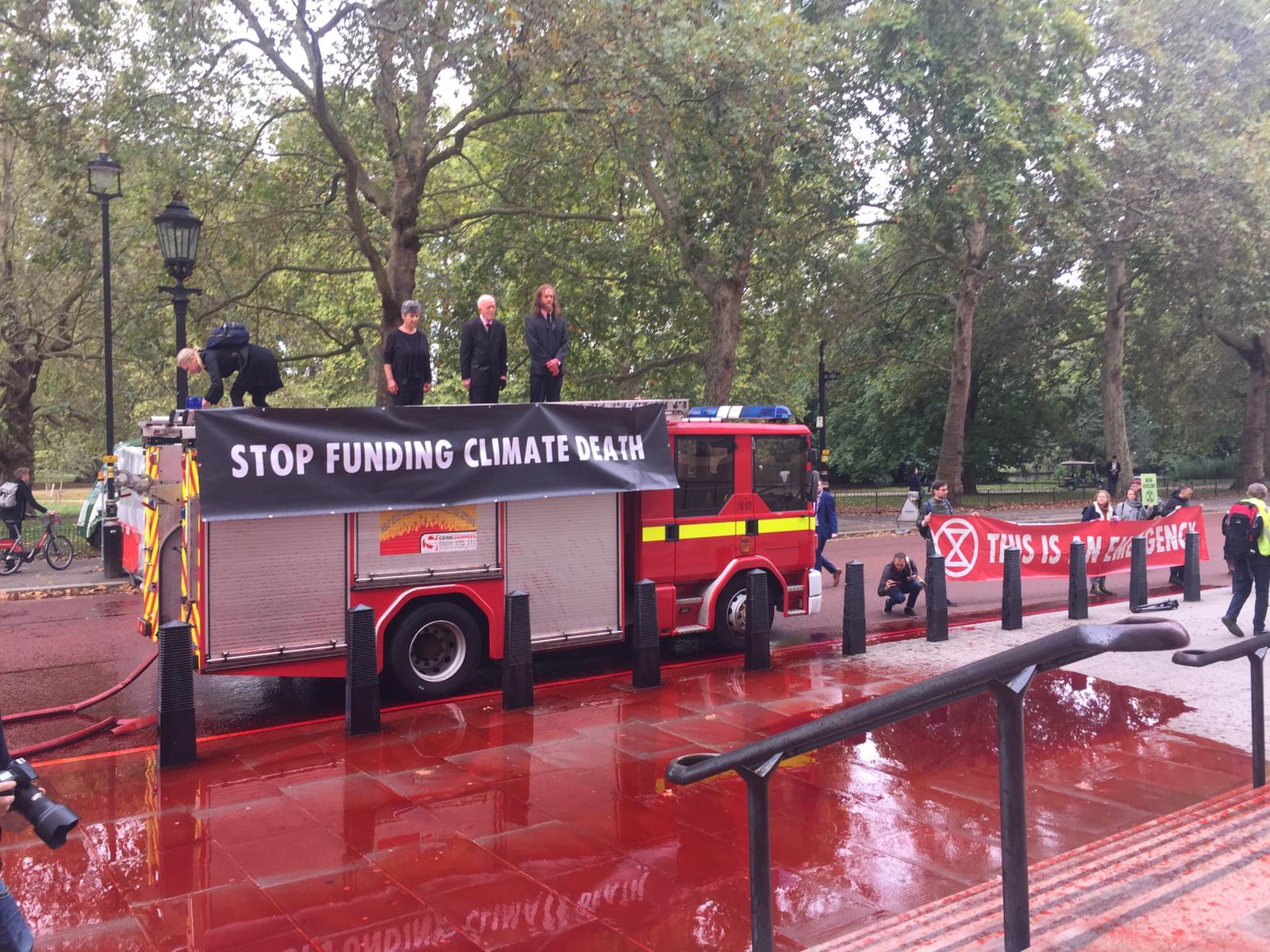 Eight arrested after Extinction Rebellion loses control of fake blood fire hose