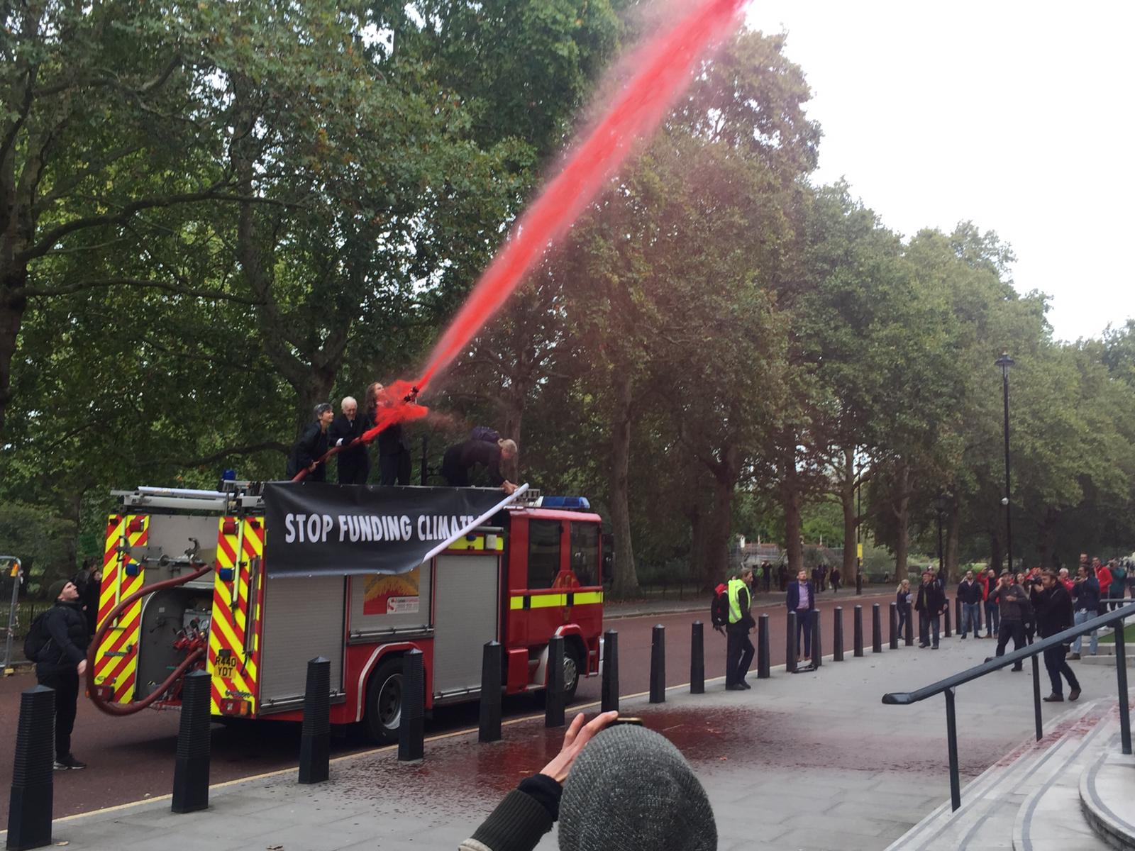 Extinction Rebellion protesters spray 1,800 litres of fake blood on Treasury building