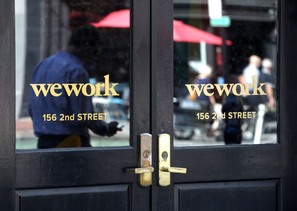 SAN FRANCISCO, CALIFORNIA - OCTOBER 07: A pedestrian walks by a WeWork office on October 07, 2019 in San Francisco, California. Days after withdrawing its registration for an initial public offering, WeWork also warned employees that the company could be set to lay off nearly 2,000 people, about 16 percent of its workforce. (Photo by Justin Sullivan/Getty Images)
